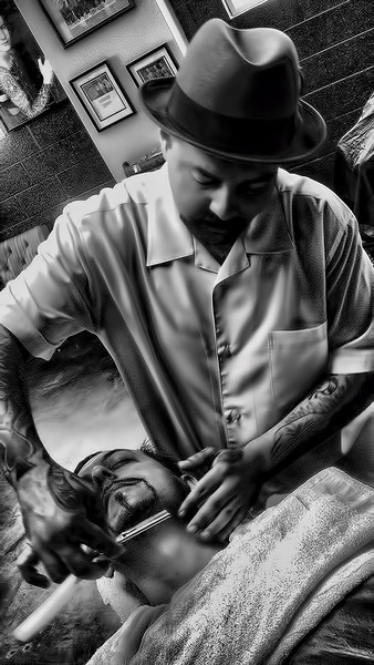 "Me getting a shave at ""The Parlor "" Barber Shop in Westminster California by the Famous Andy .  This image was taken with a Sony DSC T1 Hand Held point and shoot .   This is a single image HDR File , I created to other exposures 2 steps lower and Higher ."